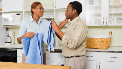 mother teaching her teenager with ADHD how to do laundry, an important life skill