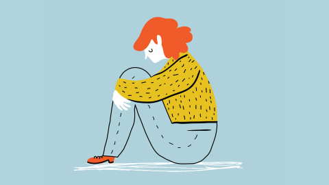 a woman with ADHD sits by herself feeling sad and lonely because she finds it hard to make friends
