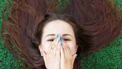 ADHD girl covering mouth