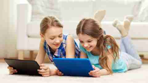 Girls are trying to overcome executive function disorder using tablets.
