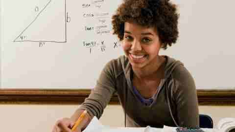 A student studies math by doing practice problems, a good strategy for dealing with the symptoms of ADHD in high school