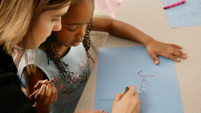 A teacher guides a student, employing a common strategy to help ADHD students learn.