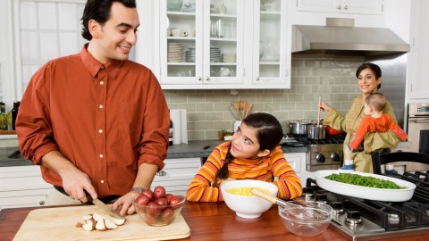 A family cooking together and talking about easy meal planning strategies they can use