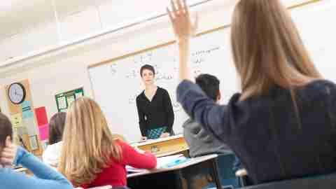 A student raises her hand to ask the teacher a question about ADHD and college