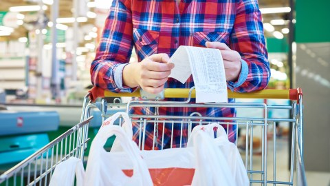 Woman with ADHD looking at check in grocery store