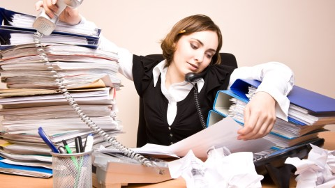 Multitasking to the extreme, like this woman here, can hinder your effort to get things done by increasing distractions and slowing your thinking.