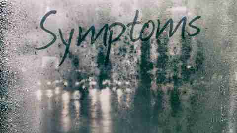 The word symptoms written in fog on a window. Do you know the symptoms of social anxiety disorder?