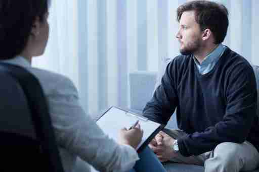 A depressed man with ADHD talks to his therapist about which condition they should address with CBT first.