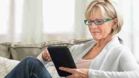 A woman reads more about symptoms of ADHD and related conditions to decide is she needs an adult ADHD test.