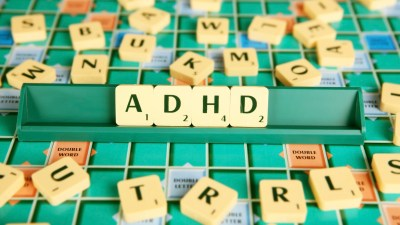 A scrabble board with ADHD spelled out.