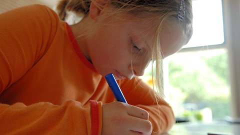A girl working in a silent and distraction free environment, an efficient way to improve classroom behavior.