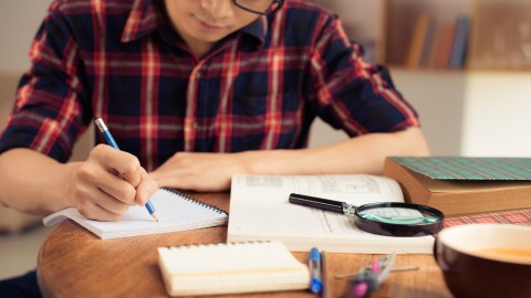 A student studies at home. Interesting assignments are one way to motivate a teenager.