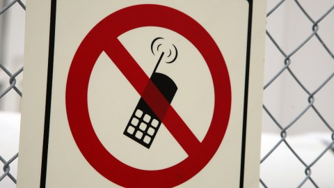 A sign that bans use of digital devices like phones and Minecraft