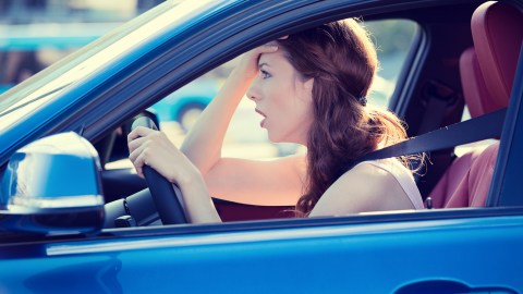 A frustrated driver with ADHD is stuck in traffic, and won't make it to work on time