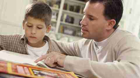 A father points out an important detail, improving his son's understanding of the assignment and lowering homework stress.