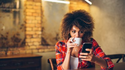 Woman with ADHD looking at her phone apps that improve productivity