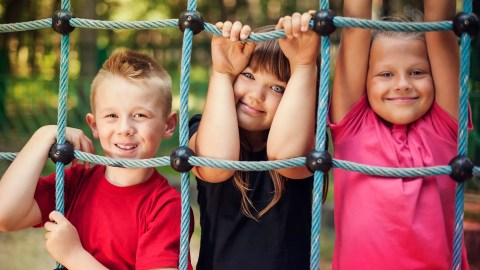 Kids with ADHD learn how to make friends on the playground by sharing the cargo net