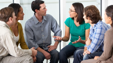 A support group meets to discuss ADHD parenting strategies