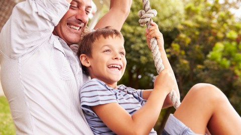 A dad swings with his son who has ADHD as a reward for cleaning up his messy bedroom.