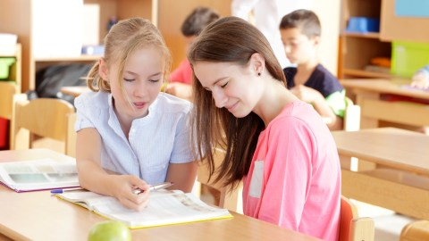 A student with ADHD shows another student strategies for learning