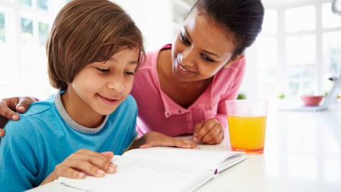 A boy and his mother use ADHD homework strategies to finish assignments.