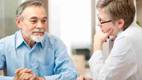 Older man discussing ADHD with his doctor