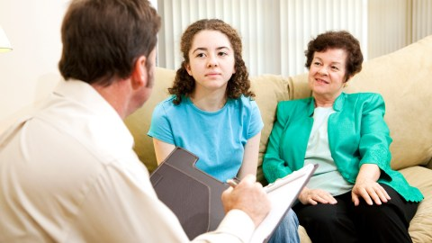 Young girl with mother at doctors' appointment