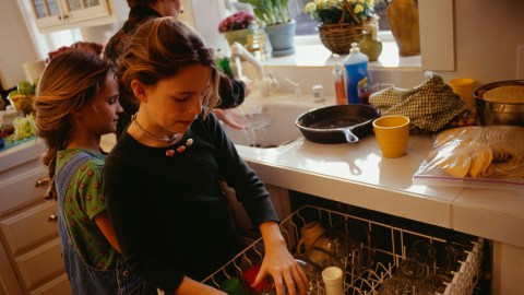 A young girl helps with household chores during the holidays to help her parents with stress relief