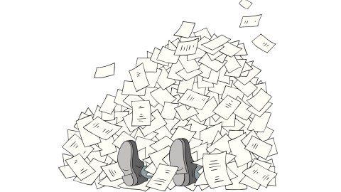 A man buried in a mountain of incomplete work when he needs to be getting things done.