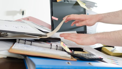 A cluttered desk, which can make a person with ADHD feel too overwhelmed to get things done