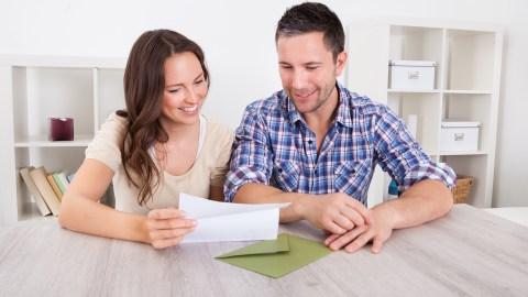A couple goes through paperwork and plans how to get things done