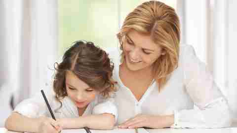 A mother helping her daughter plan her homework and build her executive functions