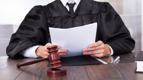 A judge reads a sentence — a metaphor for a therapist who makes incorrect assumptions about people with ADHD.