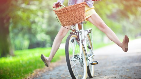 A woman with ADHD practices mindfulness techniques while riding her bike