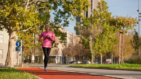 A woman with ADHD practices mindfulness techniques while going running