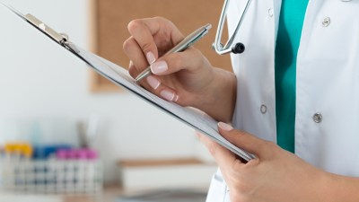 A doctor fills out a perscription for ADHD medications.