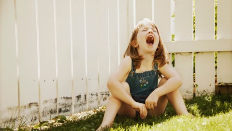 A child throwing an ADHD tantrum.