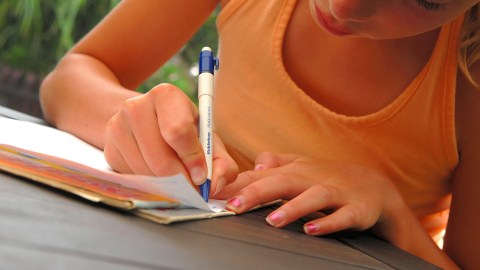 A girl writes out her feelings to avoid having an ADHD tantrum