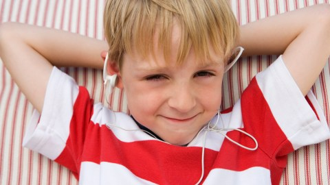 A boy with ADHD listens to music to avoid having a tantrum.