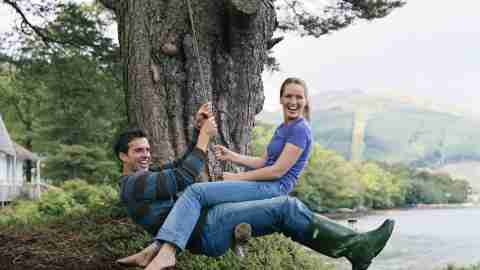Adults swing on a tree, treasuring their weirdness, not hiding it.