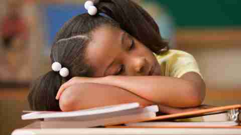 A student daydreaming in class which 504 accomodations for adhd could improve by encouraging focus and engagement.