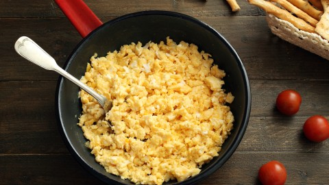Scrambled eggs in a pan, one of several ADHD recipes that are high in protein