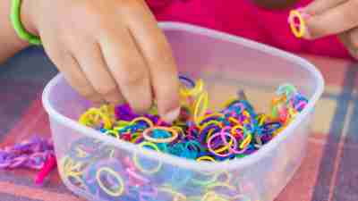 A child with ADHD plays with a basket of fidgets