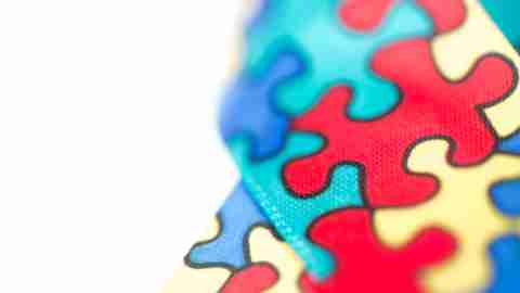 Fabric with multi-colored puzzle pieces that represents autism, a diagnosis that many learning disabilities are confused with