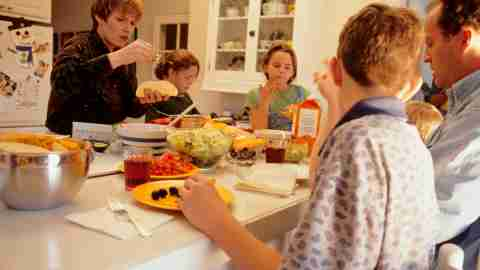 A mom with ADHD helping her family prepare dinner
