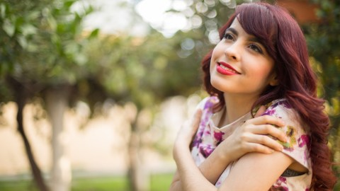 A woman with ADHD gives herself a hug, fighting shame with self-acceptance.