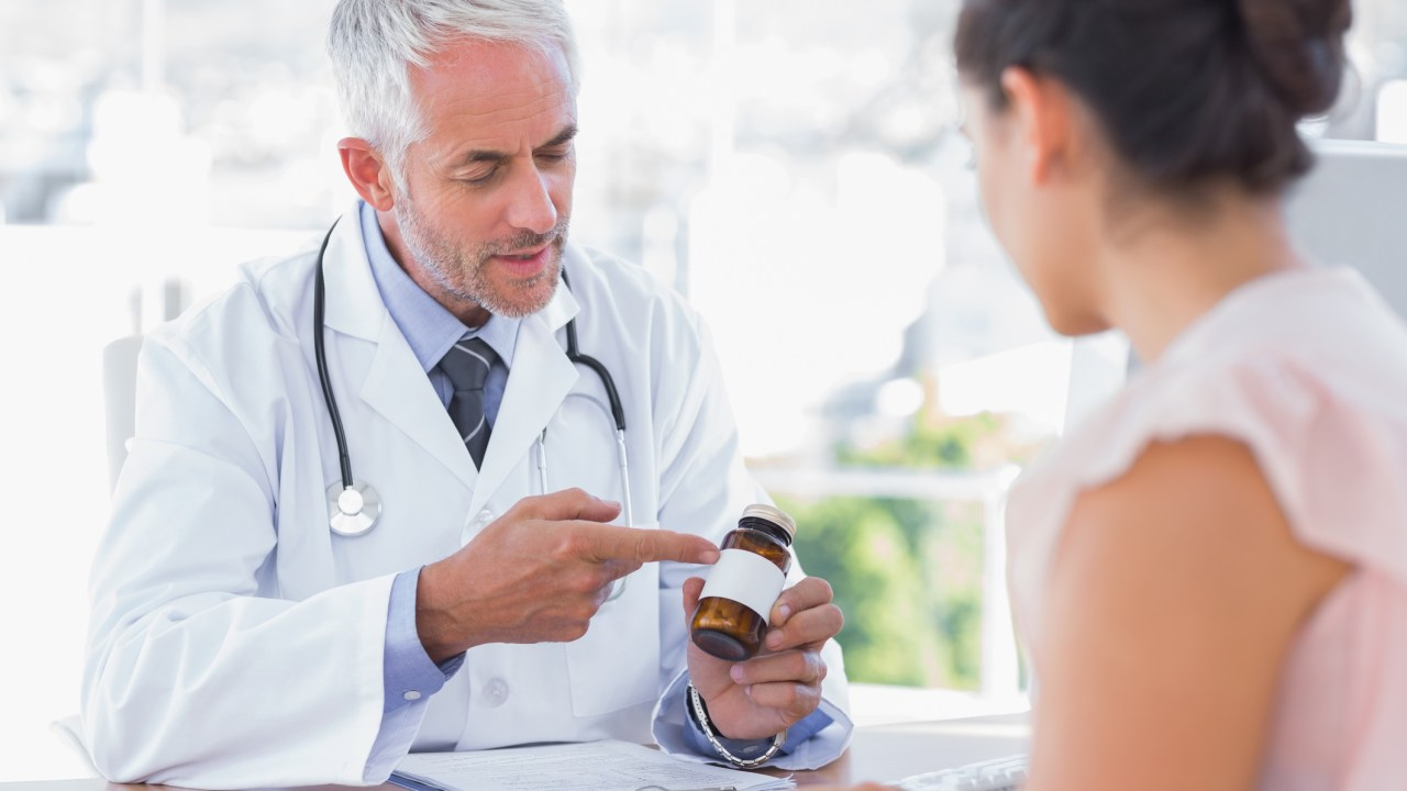 A doctor holds a pill bottle and explains that there is no average dose of Adderall to his patient.