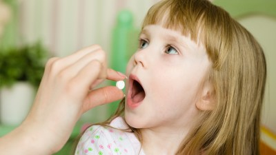 A girl with ADHD takes an afternoon dose of medication to avoid an afterschool meltdown.