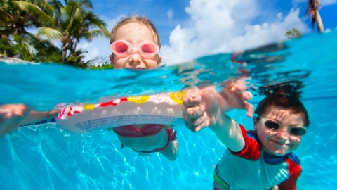 Two children with ADHD swimming at summer camp