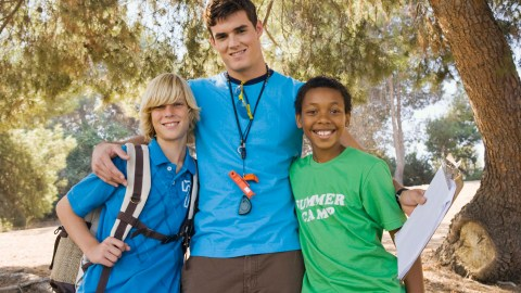 A counselor with two campers at a summer camp for kids with ADHD